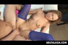 Cockslut in white stockings takes a thick cock on her ass.