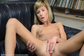 Sexy girl plays with a dildo and pussy.