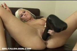 Babe sucking a dildo and playing wit her tight pussy.