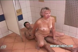 Young and hung stud jerks off in shower.