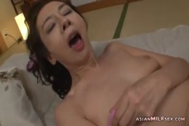 Masturbating with a vibrator in my ass.