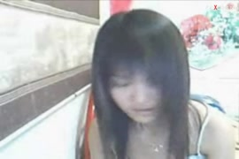 Cute chinese teen plays with herself in bath tub.