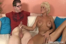 Horny young stud jerks off huge load.